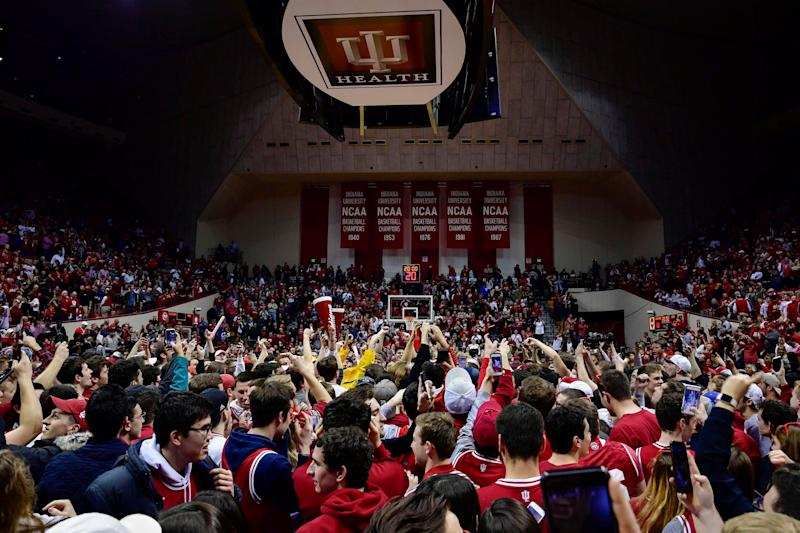 Indiana's student section rushes the court after the Hoosiers stun Michigan State on Saturday