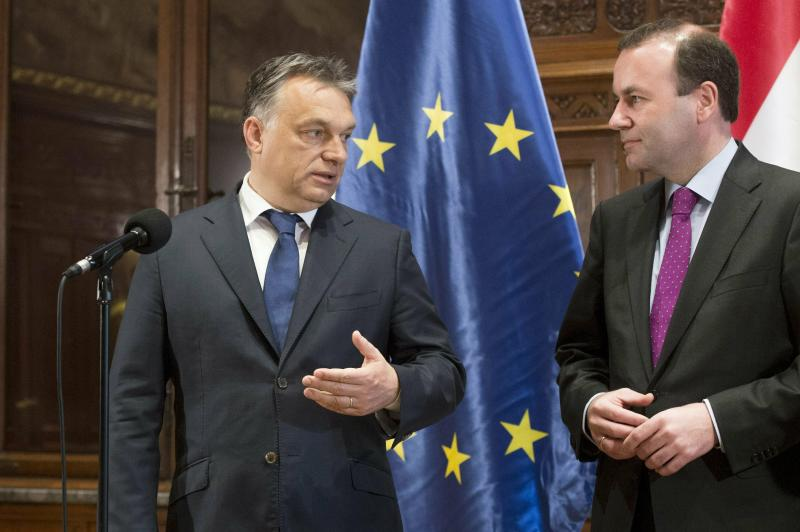 File - In this Thursday, June 4, 2015, file photo, Hungarian Prime Minister Viktor Orban, left, and group leader of the European People's Party, EPP, Manfred Weber, right, give a statement following their talks at the Hungarian Parliament in Budapest, Hungary. (Szilard Koszticsak/MTI via AP, File)