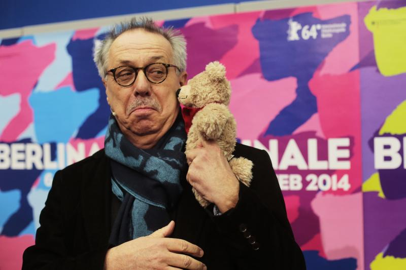 Dieter Kosslick director of the International Film Festival Berlin, the Berlinale, poses with a Berlinale bear for media prior to the annual program press conference in Berlin, Germany, Tuesday, Jan. 28, 2014. The 64. Berlinale will take place in the German capital from Thursday, Feb. 6, until Sunday, Feb. 16, 2014. (AP Photo/Markus Schreiber)