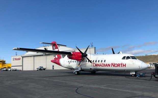 A Canadian North plane in July 2019. Two people on one of the airline's flights on Friday were identified as contacts of a confirmed COVID-19 case after they were in the air, on their way from Iqaluit to Rankin Inlet, said public health. (Jordan Konek/CBC - image credit)