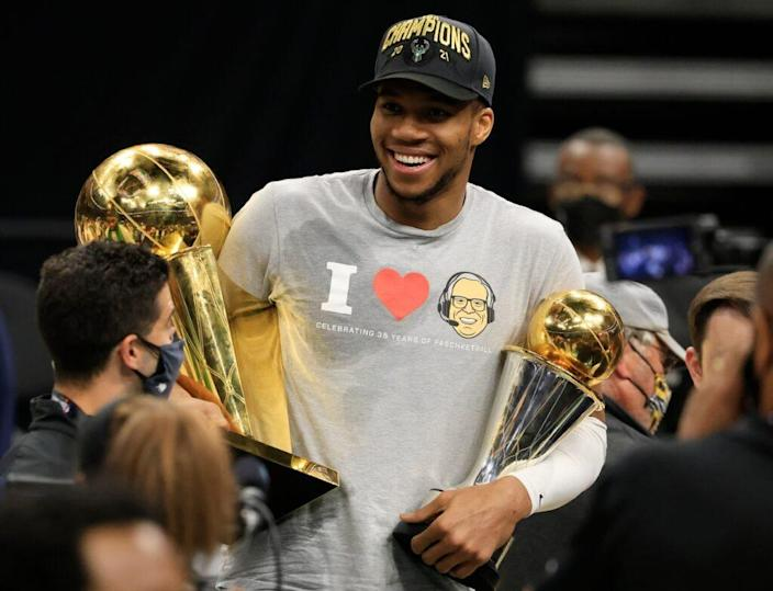 Giannis Antetokounmpo takes trophies to Chick-fil-A for ...