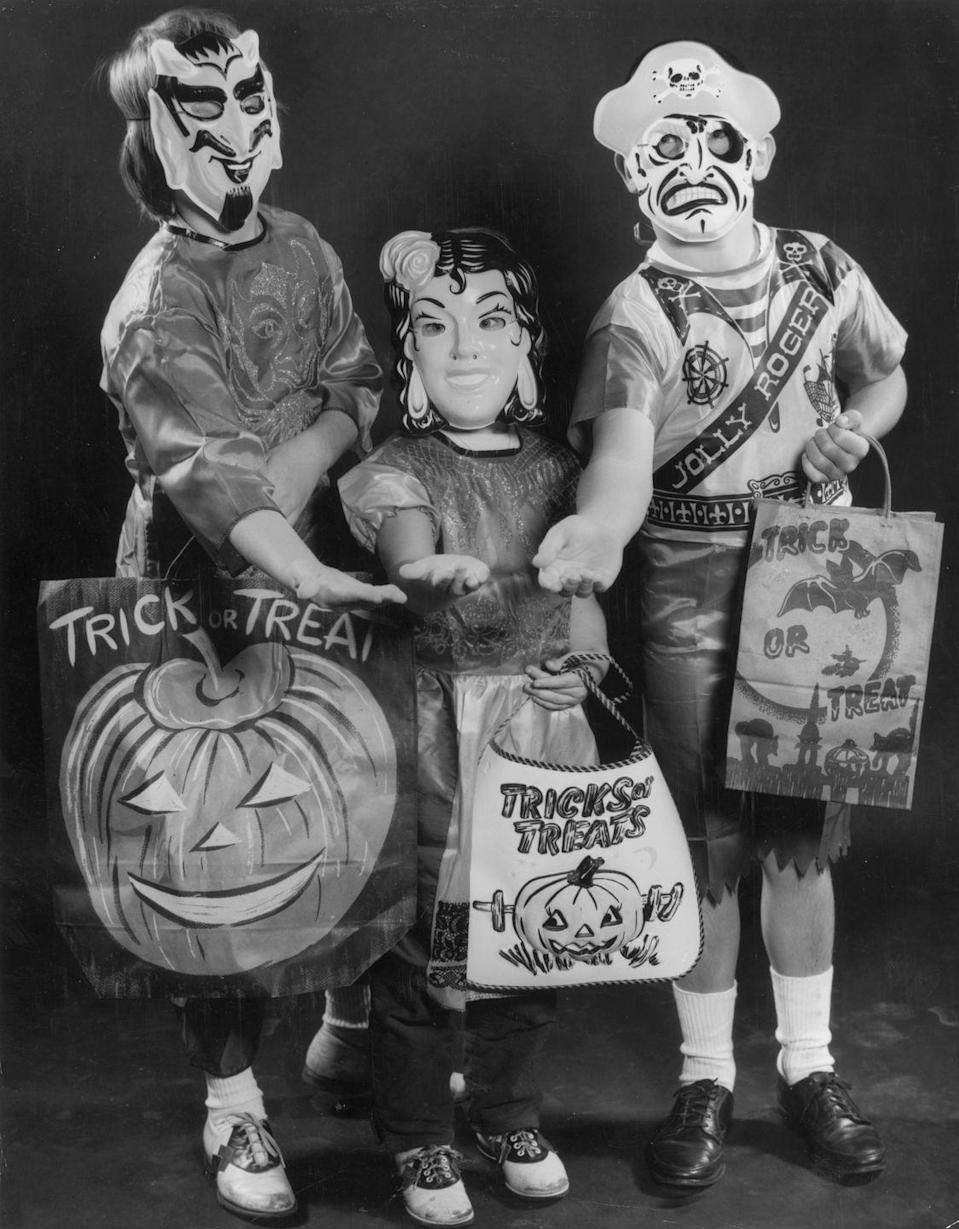 <p>The costumes of the '70s were simple, affordable, and stress-free. They typically consisted of a full-face mask and a plastic smock—like the ones seen here—and the whole thing came ready to wear, in a box. Popular picks during this decade included Wonder Woman, Raggedy Ann, and Barbie. </p>