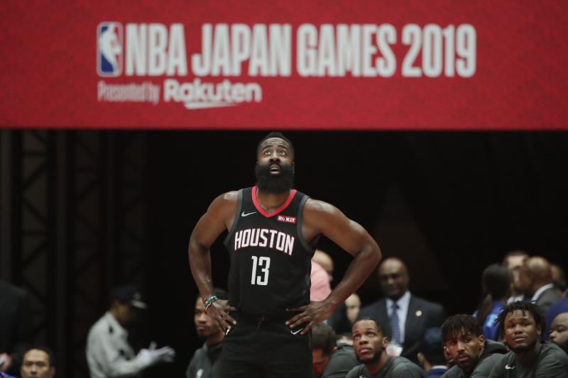 Houston Rockets' James Harden stands near the team bench during the first half of an NBA preseason basketball game against the Toronto Raptors Tuesday, Oct. 8, 2019, in Saitama, near Tokyo. (AP Photo/Jae C. Hong)