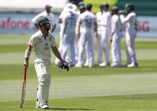 Australia's Matthew Wade walks from the field after he was dismissed for 30 runs during play on day one of the Boxing Day cricket test between India and Australia at the Melbourne Cricket Ground, Melbourne, Australia, Saturday, Dec. 26, 2020. (AP Photo/Asanka Brendon Ratnayake)