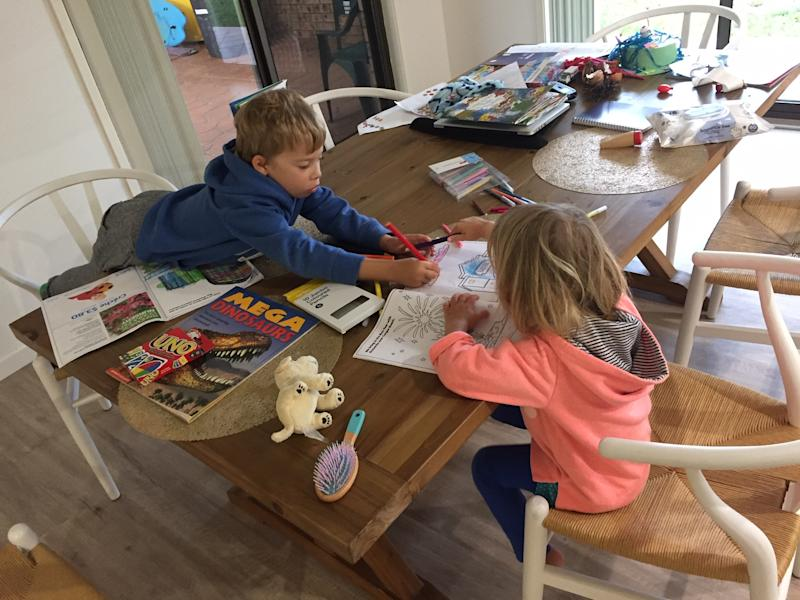 Kids playing at a kitchen table