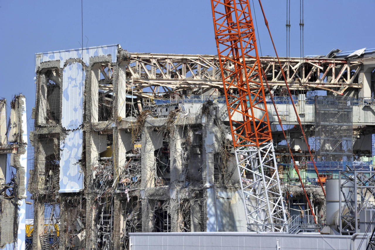 Crippled Unit 4 reactor building of Tokyo Electric Power Co., Fukushima Dai-ichi nuclear power plant is seen in Okuma town, Fukushima prefecture, northeastern Japan Tuesday, Feb. 28, 2012. Japan next month marks one year since the March 11 tsunami and earthquake, which triggered the worst nuclear accident since Chernobyl in 1986. (AP Photo/Yoshikazu Tsuno, Pool)