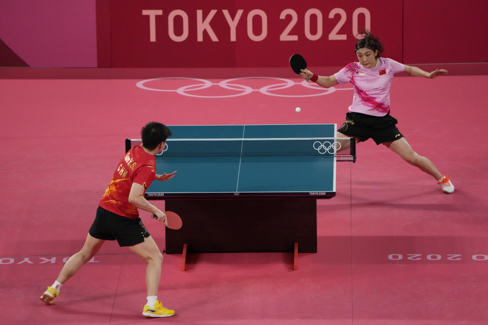 China's Chen Meng, top, competes against countrywoman Sun Yingsha during the gold medal match of the table tennis women's singles at the 2020 Summer Olympics, Thursday, July 29, 2021, in Tokyo. (AP Photo/David Goldman)