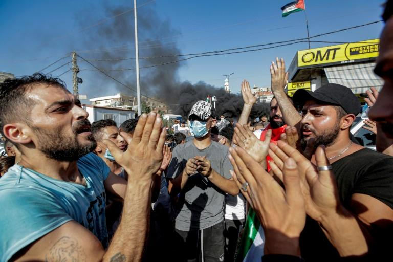 Palestinians protest against a labour crackdown, outside a refugee camp south of the Lebanese capital Beirut