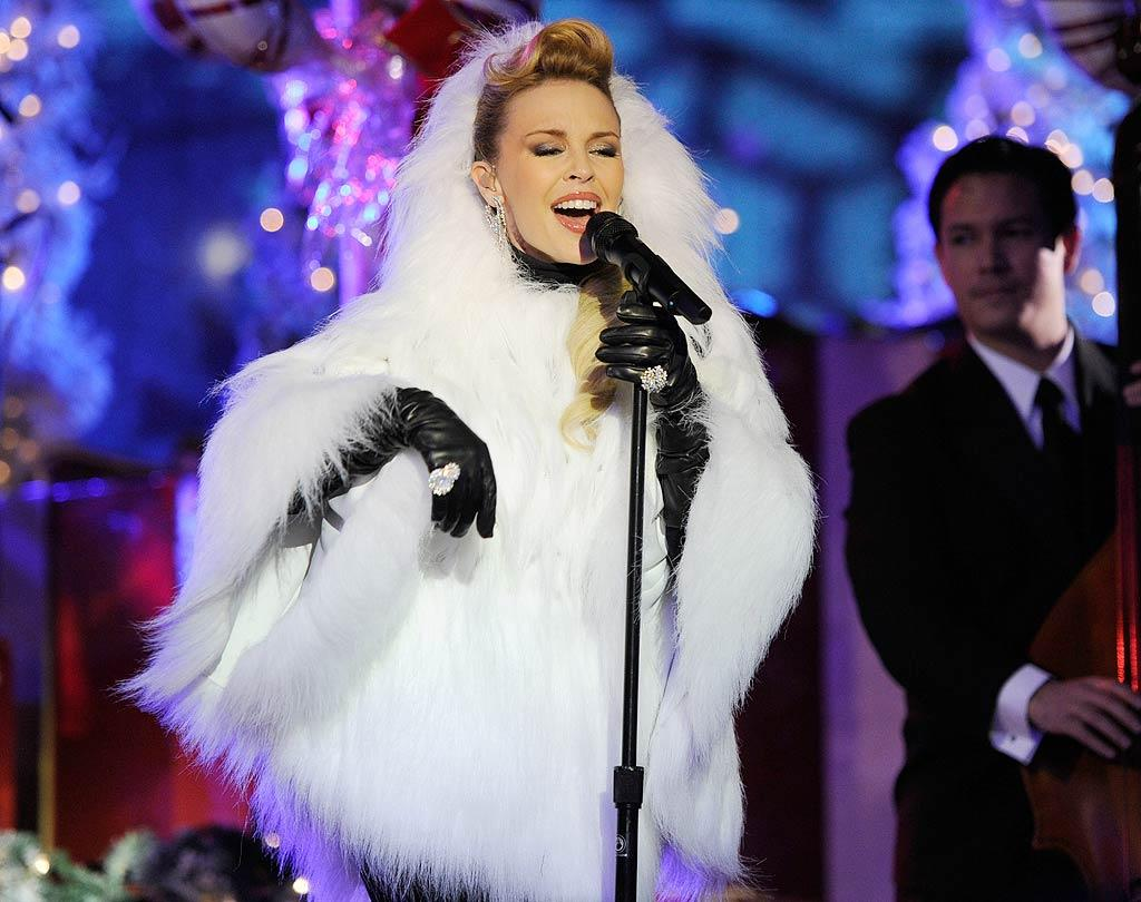 """Sporting a Yeti-esque white fur poncho, Aussie pop star Kylie Minogue pepped up the chilly crowd with a fun version of her hit Xmas hit """"Santa Baby."""" Do you think her outfit is hot ... or not? Kevin Mazur/<a href=""""http://www.wireimage.com"""" target=""""new"""">WireImage.com</a> - November 30, 2010"""