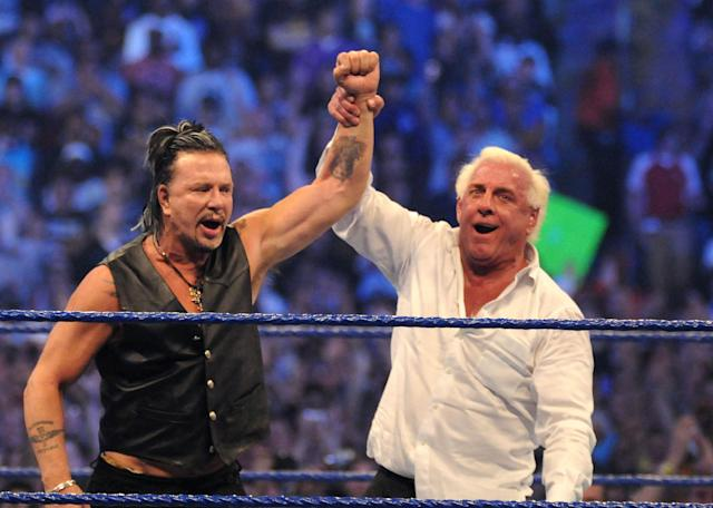"<p>""Nature Boy"" Ric Flair raises the arm of actor Mickey Rourke after he knocked out Chris Jericho at WrestleMania 25 at the Reliant Stadium on April 5, 2009 in Houston, Texas. (Photo by George Napolitano/FilmMagic) </p>"