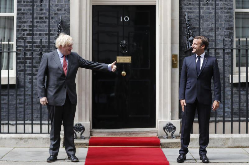 British Prime Minister Boris Johnson, left, meets with French President Emmanuel Macron at 10 Downing Street in London, Thursday, June 18, 2020. The President of the French Republic visits London to celebrate the 80th Anniversary of General de Gaulle's 'Appel' to the French population to resist the German occupation of France during WWII. (AP Photo/Frank Augstein, pool)