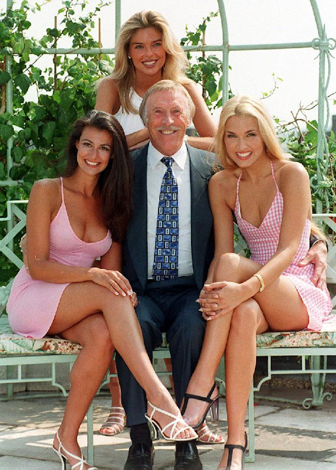 <p>Sir Bruce Forsyth joined by three assistants in 1995, Kimberley Cowell (left) Emma Noble (right) and Emma Steadman (PA) </p>
