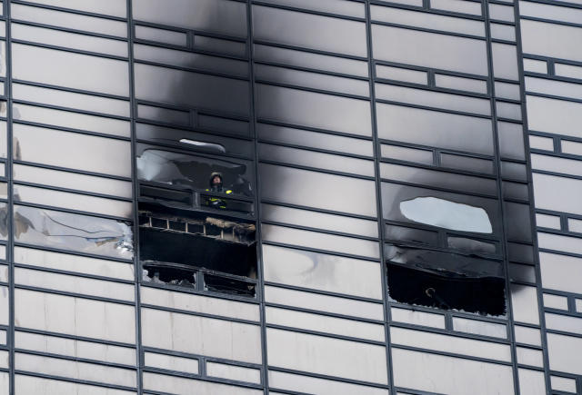 A firefighter looks out from the window of a fire damaged apartment in Trump Tower in New York on Saturday, April 7, 2018. The Fire Department says the blaze broke out on the 50th floor.  <span>The apartment in Trump Tower, where a man was killed in the raging fire, did not have sprinklers.  </span>(AP Photo/Craig Ruttle)