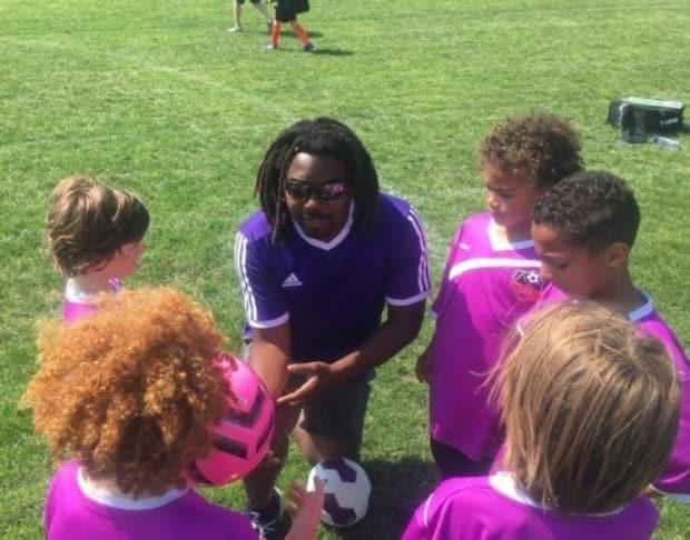 Malam Mbarak, founder and owner of the Umoja Soccer School in Toronto, has found the fitness level of his young players dropped dramatically after months at home. Research indicates it'll be difficult to get young people moving again at pre-pandemic levels.  (Kevin Jones - image credit)
