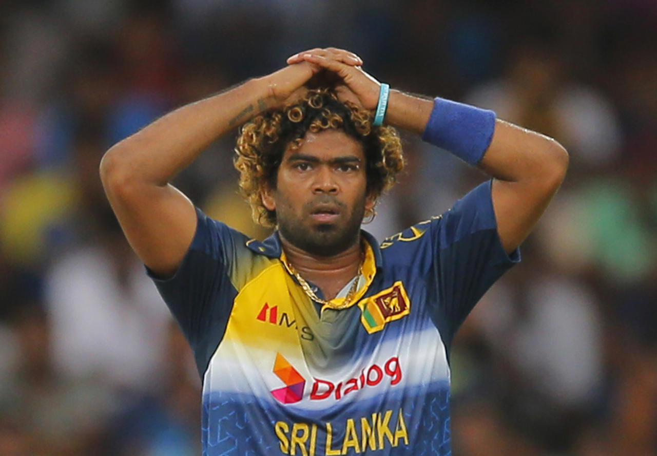 FILE- In this Sunday, Nov. 1, 2015 file photo, Sri Lanka's Lasith Malinga reacts during their first one day international cricket match against West Indies in Colombo, Sri Lanka. Malinga pleaded guilty to a charge of speaking to the media without permission, Sri Lanka's cricket board said Tuesday, June 27, 2017, after the fast bowler responded to criticism of the team's fitness levels. (AP Photo/Eranga Jayawardena, File)