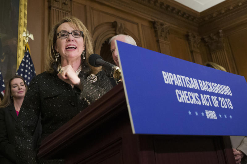 FILE - In this Jan. 8, 2019, file photo, former Rep. Gabby Giffords, speaks during a news conference to announce the introduction of bipartisan legislation to expand background checks for sales and transfers of firearms, on Capitol Hill in Washington. Two prominent gun safety organizations say they'll host a forum for Democratic presidential candidates in Las Vegas on Oct. 2, the day after the second anniversary of the deadliest mass shooting in modern U.S. history. March For Our Lives and the Giffords group told The Associated Press that the forum is the first of its kind for presidential hopefuls. (AP Photo/Alex Brandon, File)