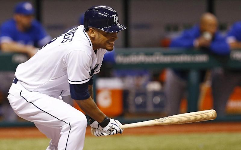 Tampa Bay Rays' Desmond Jennings reacts as his line drive hits Toronto Blue Jays starting pitcher J.A. Happ in the head during the second inning of a baseball game Tuesday, May 7, 2013, in St. Petersburg, Fla. (AP Photo/Mike Carlson)