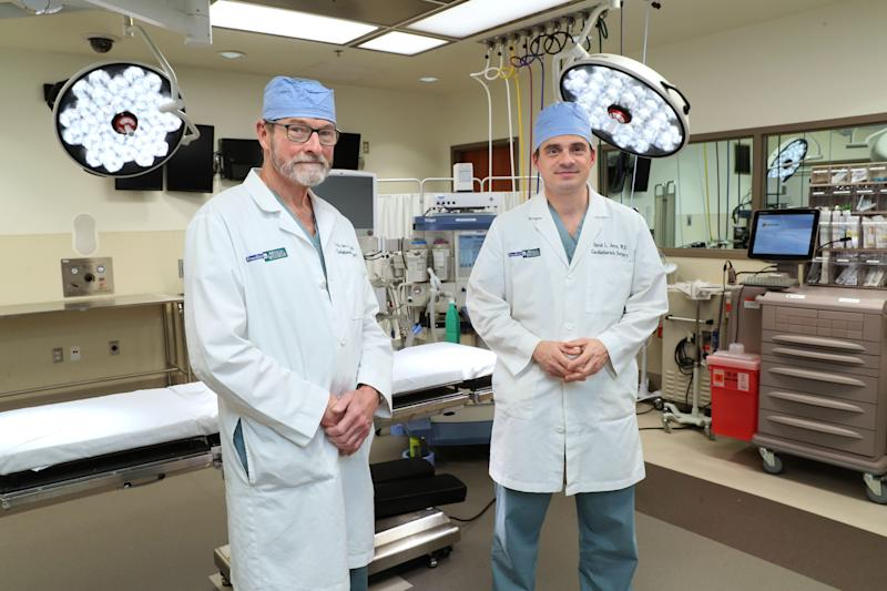 Lyle Joyce, left, and his son, David Joyce, both cardiothoracic surgeons, performed a lifesaving second heart transplant in March on Chuck Newman. Lyle Joyce also did the first transplant for Newman in 1988. The surgeons are standing in a simulation lab used for training those involved with surgery at Froedtert & the Medical College of Wisconsin.