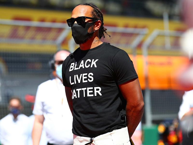 Lewis Hamilton wore a Black Lives Matter T-shirt and took a knee before the Austrian Grand Prix: Getty
