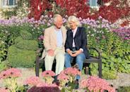 <p>On the same day the Cambridges released their Christmas card for 2020, so too did Prince William's father Prince Charles and his wife Camilla, the Duchess of Cornwall. </p><p>Taken by a member of their staff earlier this Autumn, the married couple of 15 years smile while sat on a bench in the picturesque flower-filled garden of Birkhall in Scotland, Charles and Camilla's Scottish residence in the Balmoral estate.</p>