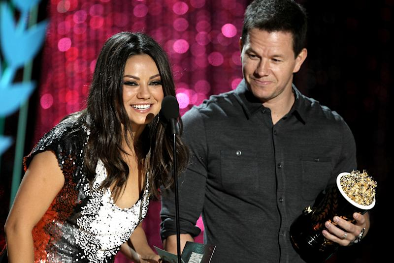 Mila Kunis, left and Mark Wahlberg present the award for best on-screen dirtbag at the MTV Movie Awards on Sunday, June 3, 2012 in Los Angeles. (Photo by Matt Sayles/Invision/AP)