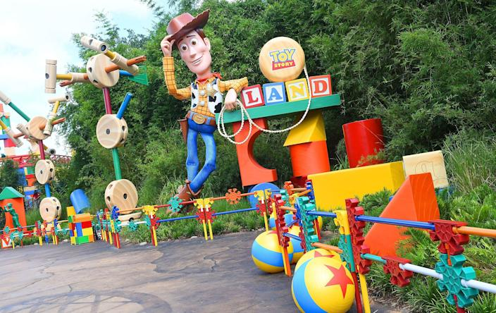 "Woody welcomes fans to Toy Story Land, which is full of details from the movies. For example, the yellow ball with a blue stripe and red star is a classic staple of ""Toy Story"" and Pixar."