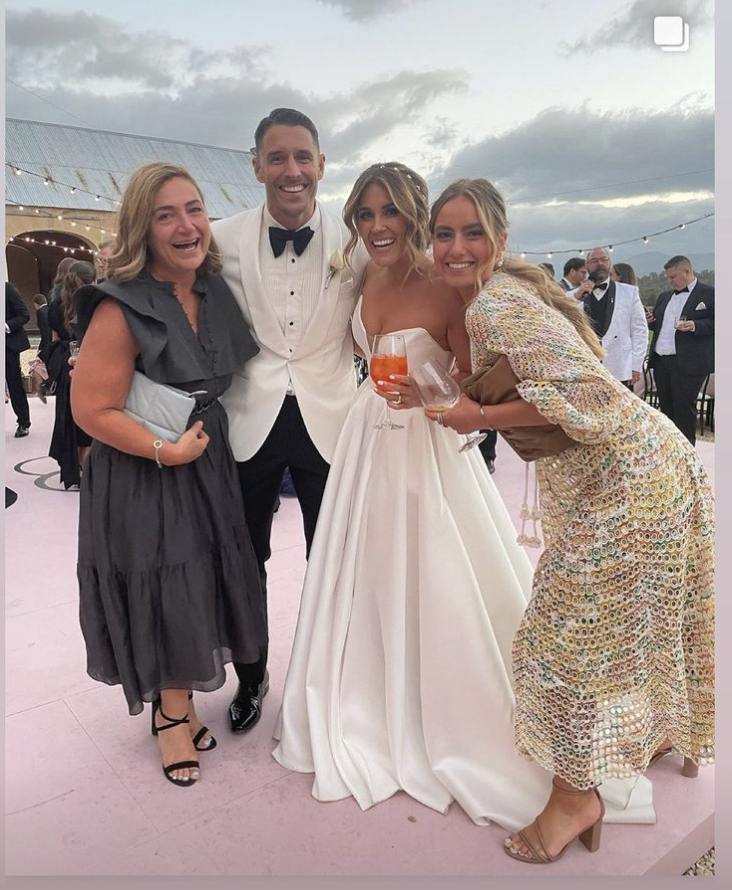 Georgia Love, Lee Elliott and their guests at their wedding