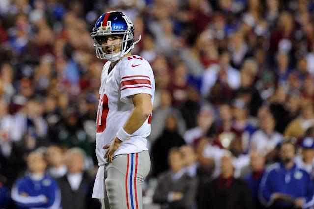 LANDOVER, MD - DECEMBER 03: Quarterback Eli Manning #10 of the New York Giants reacts in the first half while taking on the Washington Redskins at FedExField on December 3, 2012 in Landover, Maryland. (Photo by Patrick McDermott/Getty Images)