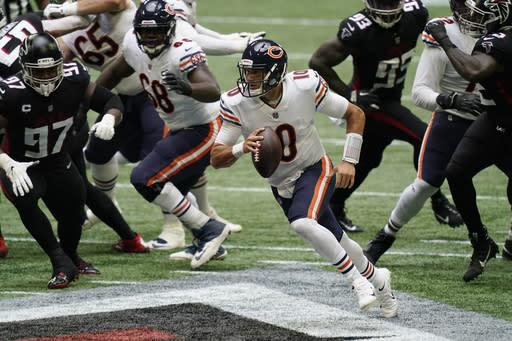 Chicago Bears quarterback Mitchell Trubisky (10) runs out of the pocket against the Atlanta Falcons during the first half of an NFL football game, Sunday, Sept. 27, 2020, in Atlanta. (AP Photo/Brynn Anderson)