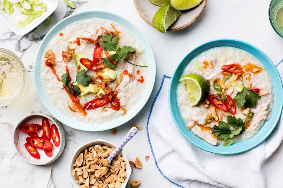 """Congee is a savory rice porridge often served for breakfast in China. Here, we simplify it by using boneless, skinless chicken thighs cooked with rice in a slow-cooker for a super comforting set-it-and-forget it dinner. Pick and choose from as many toppings as you like to dress up each serving. <a href=""""https://www.epicurious.com/recipes/food/views/slow-cooker-chicken-congee?mbid=synd_yahoo_rss"""" rel=""""nofollow noopener"""" target=""""_blank"""" data-ylk=""""slk:See recipe."""" class=""""link rapid-noclick-resp"""">See recipe.</a>"""