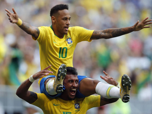 <p>Brazil's Neymar, top, celebrates with team mate Paulinho after scoring his side's opening goal during the round of 16 match between Brazil and Mexico at the 2018 soccer World Cup in the Samara Arena, in Samara, Russia, Monday, July 2, 2018. (AP Photo/Frank Augstein) </p>