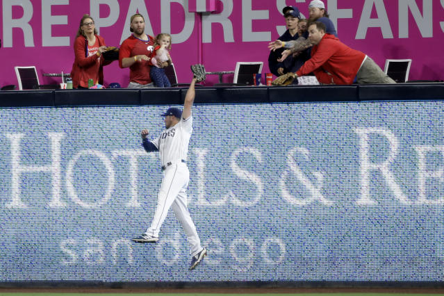 San Diego Padres right fielder Hunter Renfroe makes a catch at the wall for the out on Philadelphia Phillies' Phil Gosselin during the eighth inning of a baseball game, Monday, June 3, 2019, in San Diego. (AP Photo/Gregory Bull)
