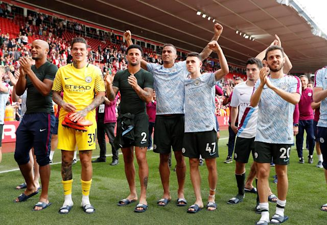 "Soccer Football - Premier League - Southampton vs Manchester City - St Mary's Stadium, Southampton, Britain - May 13, 2018 Manchester City's Vincent Kompany, Ederson, Kyle Walker, Danilo, Phil Foden and Bernardo Silva celebrate after the match Action Images via Reuters/John Sibley EDITORIAL USE ONLY. No use with unauthorized audio, video, data, fixture lists, club/league logos or ""live"" services. Online in-match use limited to 75 images, no video emulation. No use in betting, games or single club/league/player publications. Please contact your account representative for further details."