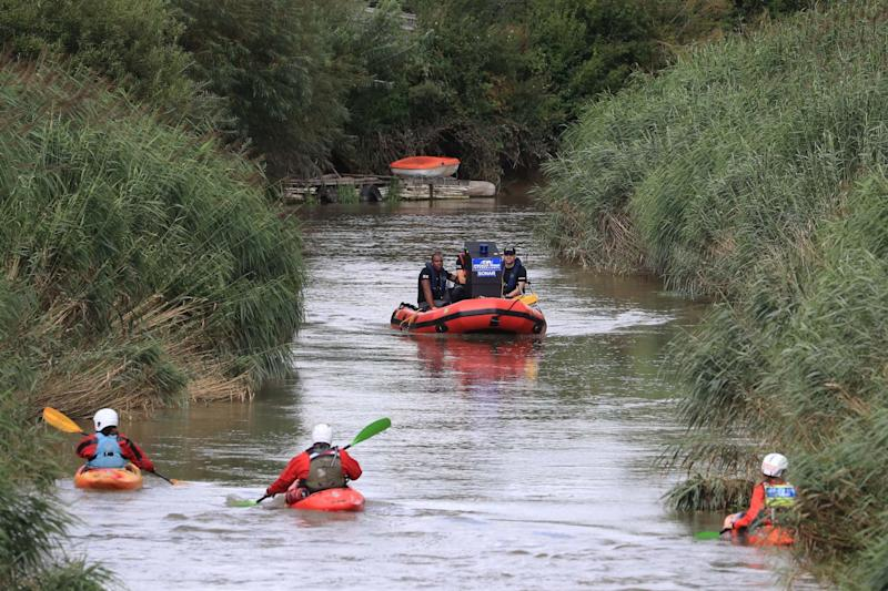 Specialist search groups search a section of the River Stour for missing six-year-old Lucas Dobson (PA)