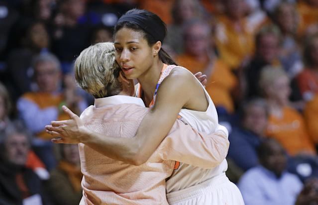 Tennessee head coach Holly Warlick hugs Isabelle Harrison as Harrison leaves the game late in the second half of an NCAA women's college basketball second-round tournament game against St. John's Monday, March 24, 2014, in Knoxville, Tenn. Tennessee won 67-51. (AP Photo/Mark Humphrey)
