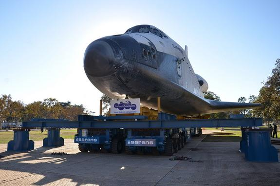 """Space shuttle Endeavour is seen approaching the California Science Center at the end of its three-day, 12-mile (19 km) """"Mission 26"""" road trip, Oct. 14, 2012."""