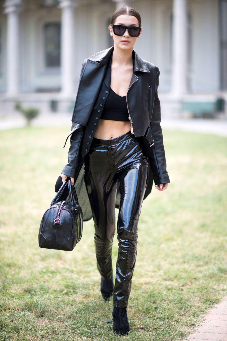 <p>In a leather jacket and latex pants during Milan Fashion Week Spring 17.</p>