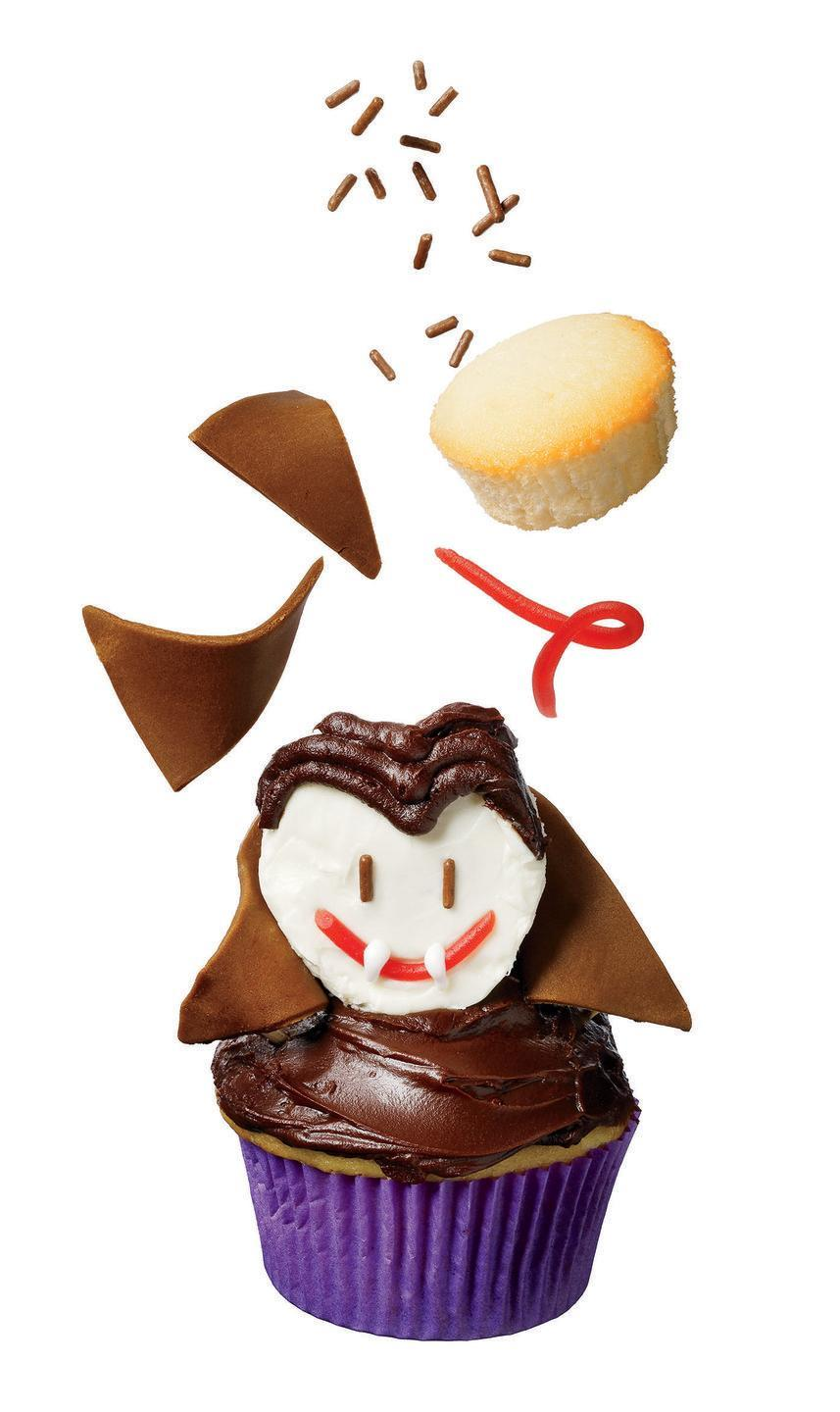 """<p>You'll want to take a bite of this: It's a mini cupcake for the face, and Tootsie Rolls, licorice strings and frosting for Dracula's features.</p><p><em><a href=""""https://www.womansday.com/food-recipes/food-drinks/recipes/a11432/fangtastic-dracula-cupcake-recipe-122728/"""" rel=""""nofollow noopener"""" target=""""_blank"""" data-ylk=""""slk:Get the recipe from Woman's Day »"""" class=""""link rapid-noclick-resp"""">Get the recipe from Woman's Day »</a></em></p>"""