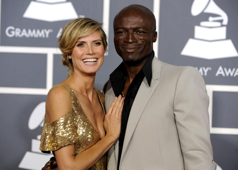 FILE - In this Feb. 13, 2011 file photo, Heidi Klum, left, and Seal arrive at the 53rd annual Grammy Awards in Los Angeles.   Klum filed for divorce Friday, April 6, 2012, in Los Angeles, citing irreconcilable differences for the end of her marriage to singer Seal. The couple married in 2005 and has four children together, including the supermodel's daughter from a previous relationship. (AP Photo/Chris Pizzello, File)