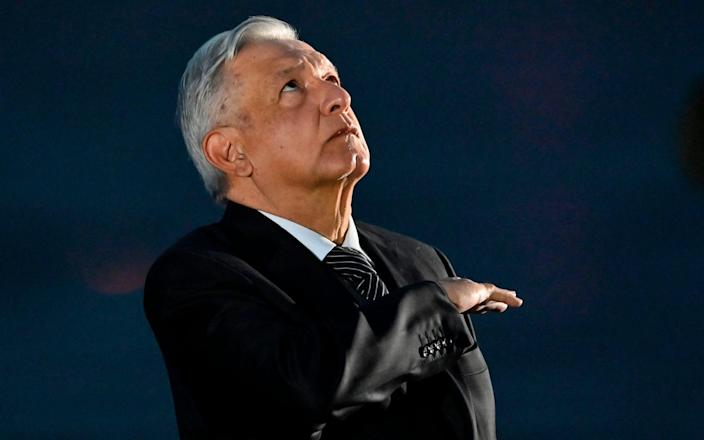 Andrés Manuel López Obrador looks to the skied, or the gods