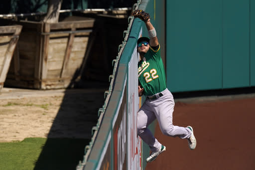 A's hit 3 HRs, Laureano's 3 fine catches help top Angels 8-4