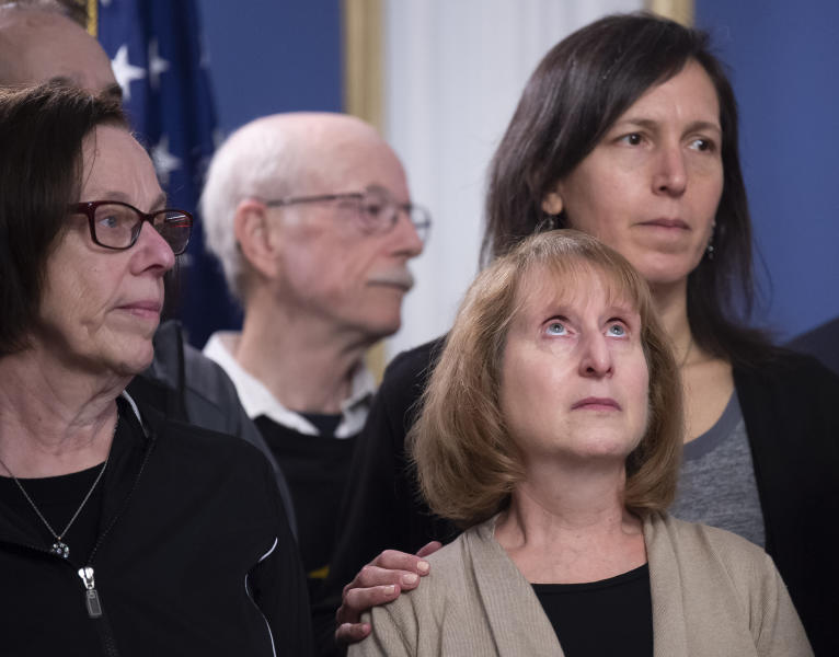 Family members Tree of Life synagogue shooting victims listen to Pittsburgh Mayor Bill Peduto after he signed three gun-control bills into law, Tuesday, April 9, 2019, at the City-County Building in downtown Pittsburgh. (Steph Chambers/Pittsburgh Post-Gazette via AP)