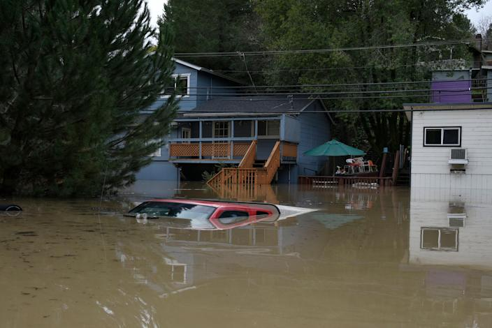A truck is seen submerged in the flood waters of the Russian River in Forestville, north of San Francisco, Feb. 27, 2019. (Photo: Michael Short/AP)