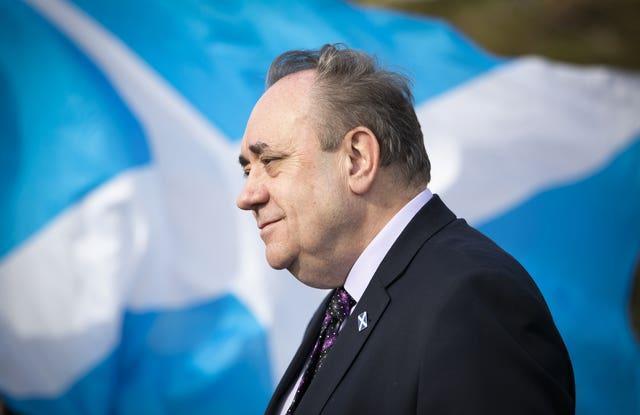 Salmond in front of a saltire
