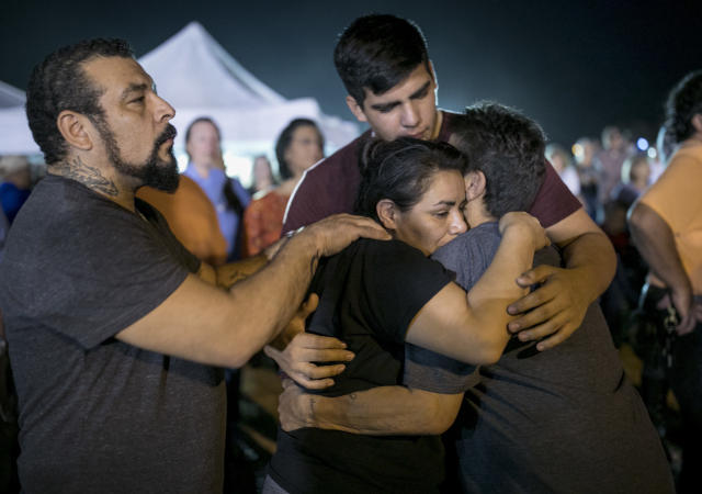 <p>Jennifer Palacios, center, the biological mother of 14-year-old Annabelle Pomeroy who died in a mass shooting in Sutherland Springs, Texas, is comforted by, from left to right, her boyfriend Fritz Rymers, her son Timothy Rodriguez and her mother Diana Palacios, at a memorial service in Sutherland Springs, Monday, Nov. 6, 2017. (Photo: Jay Janner/Austin American-Statesman via AP) </p>