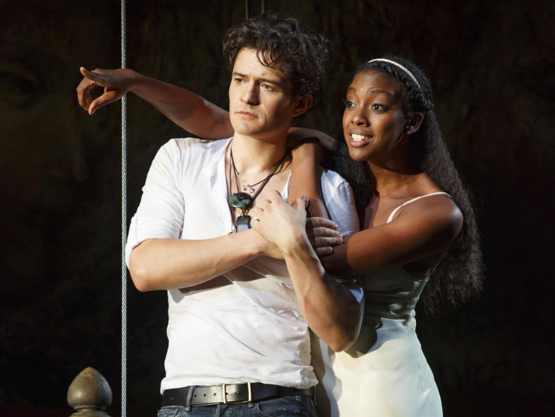 "This theater image released by The Hartman Group shows Orlando Bloom, left, and Condola Rashad during a performance of ""Romeo and Juliet,"" in New York. Content provider Screenvision and the new company BroadwayHD have teamed up to broadcast the recent Orlando Bloom-led production of ""Romeo and Juliet"" to movie theaters across the country. It marked the first time in over 36 years ""Romeo and Juliet"" had been on Broadway. (AP Photo/The Hartman Group, Carol Rosegg)"