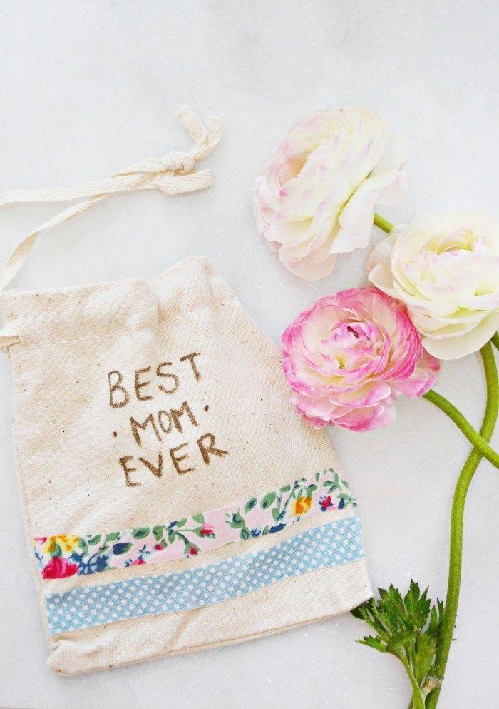"""<p>Every mom could use a sweet reminder of how much she rocks, and kids can assemble this little tote with just three crafting materials. </p><p><strong>Get the tutorial at <a href=""""http://www.ajoyfulriot.com/easy-mothers-day-gift-bags/"""" rel=""""nofollow noopener"""" target=""""_blank"""" data-ylk=""""slk:A Joyful Riot"""" class=""""link rapid-noclick-resp"""">A Joyful Riot</a>. </strong></p><p><strong><a class=""""link rapid-noclick-resp"""" href=""""https://www.amazon.com/Biodegradable-Eco-Friendly-Vegetable-Drawstring-Leafico/dp/B01N592S6B/?tag=syn-yahoo-20&ascsubtag=%5Bartid%7C10050.g.4233%5Bsrc%7Cyahoo-us"""" rel=""""nofollow noopener"""" target=""""_blank"""" data-ylk=""""slk:SHOP CANVAS BAGS"""">SHOP CANVAS BAGS</a><br></strong></p>"""