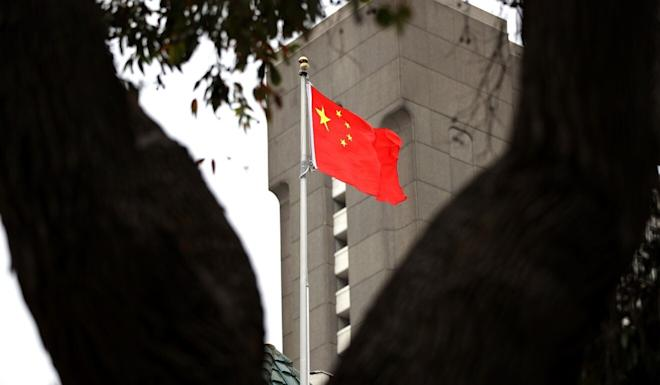 The Chinese flag flies over the Consulate General of China in San Francisco. Juan Tang, a researcher at the University of California, Davis, who took refuge in the consulate, was arrested for allegedly lying to investigators about her Chinese military service. Photo: Getty Images via AFP