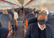 EasyJet CEO Johan Lundgren and other passengers are pictured during a flight to new Berlin-Brandenburg Airport (BER)