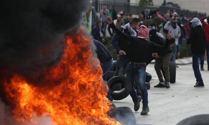 Protesters set tyres on fire during a protest in Ramallah